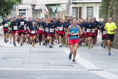Half Marathon. PONTEVEDRA, SPAIN - OCTOBER 16, 2016: Detail of participants in Popular Half Marathon City of Pontevedra 2016, through the streets of the city Royalty Free Stock Image