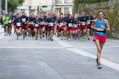 Half Marathon. PONTEVEDRA, SPAIN - OCTOBER 16, 2016: Detail of participants in Popular Half Marathon City of Pontevedra 2016, through the streets of the city Royalty Free Stock Photography