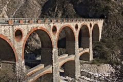 Apuan Alps, Carrara, Tuscany, Italy. March 28, 2019. Ancient bridge in the marble quarries stock photo