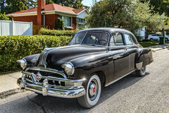 1954 Pontiac Chieftain. The Pontiac Chieftain is an automobile that was produced by the Pontiac from 1949 to 1958. Chieftains were one of the first all new car royalty free stock photo