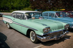 1958 Pontiac Chieftain vintage car. DEN BOSCH, THE NETHERLANDS - MAY 10, 2015: Green 1958 Pontiac Chieftain classic car royalty free stock photos