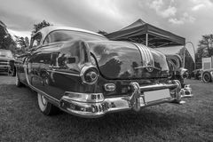 Pontiac 2-door coupe 1954 b&w. The image is shot at Fredriksten fortress in Halden, Norway during the annual classic car event Royalty Free Stock Photography