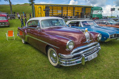 Pontiac 2-door coupe 1954. The image is shot at Fredriksten fortress in Halden, Norway during the annual classic car event Stock Image