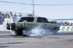 Drag racing. Napierville dragway, canada - may 18, 2014 rear side view of drag car during burnout at show time event Royalty Free Stock Images