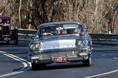 1958 Pontiac Strato Chief. Adelaide, Australia - September 25, 2016: 1958 Pontiac Strato Chief sedan driving on country roads near the town of Birdwood, South Royalty Free Stock Photos