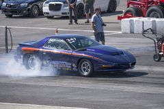 Pontiac trans am making a smoke show on the track Stock Photography