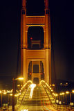Ponticello di cancello dorato alla notte Immagini Stock