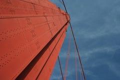 Ponticello di cancello dorato nel cielo Fotografia Stock