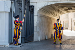 Pontifical Swiss Guards On Duty at the Vatican. VATICAN CITY, ITALY - July 26, 2015: Members of the Pontifical Swiss Guard on duty at the Vatican. At 110 members royalty free stock photo