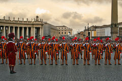 Pontifical Swiss Guards in Vatican. VATICAN - CIRCA APRIL 2005 : Pontifical Swiss Guards stand by during pope elections circa April 2005 in Vatican royalty free stock photography