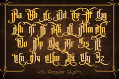The Pontifice - vintage gothic label font. Vector typeface with swashes, alternate glyphs and ligatures on the old dark background Stock Photo
