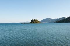 Pontikonisi Island and the Church of Pantokrator. Corfu, Greece. Royalty Free Stock Images
