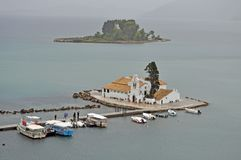 Pontikonisi island and Vlacherna. Corfu is well-known for its famous little island called Pontikonisi and in the foreground the Byzantine church of Vlacherna Royalty Free Stock Photo