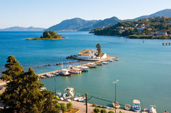 Pontikonisi and Vlacheraina monastery on Lake Chalikiopoulou seen from the hilltop of Kanoni on the island of Corfu, Greece. Royalty Free Stock Image