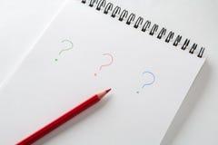 Ponto de interrogação no fundo branco Fotografia de Stock