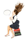 Ponto de vista alto da menina que senta-se em livros e em gritaria Fotografia de Stock Royalty Free