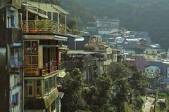 Ponto de vista de Jiufen, Taiwan – 28 de fevereiro de 2010: Custume não identificado imagens de stock royalty free