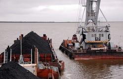 Ponton crane and barge with coal at Kolyma river Royalty Free Stock Photos