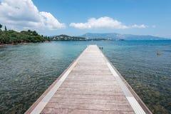 Pontoon on a beach of Ionian Sea, Corfu island. Pontoon on a beach of Ionian Sea  in Greece, Corfu Royalty Free Stock Photography