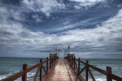 Pontoon Beach Nagueles in Marbella. Jetty overlooking the beach Nagueles in Marbella Royalty Free Stock Photos