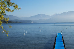 Pontoon with blue carpet and Lake Annecy Stock Images