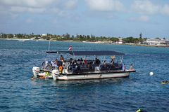 Pontoon boat at Grand Caymen stock photography