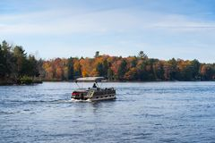 Free Pontoon Boat In The Fall Stock Images - 103056994