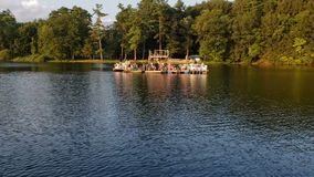 Pontoon boat party in late afternoon in the summertime. stock footage
