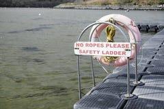 Pontoon for boats safety sign no ropes ladder at Crinan Argyll. Uk stock photo