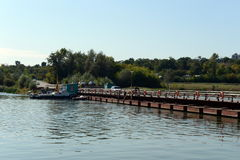 Pontoon bridge across the river Northern Donets. Royalty Free Stock Images