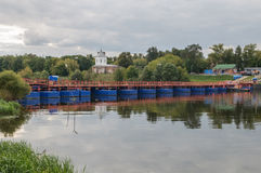 Pontoon bridge. Across the river in the summer Royalty Free Stock Images