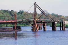 Pontoon Bridge in Henderson Louisiana, which leads to Butte Larose Over the Levee. Picture taken from a boat stock photos