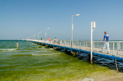 Pontoon Bridge. MAMAIA, ROMANIA - AUGUST 08: The Pontoon Bridge on August 08, 2013 in Mamaia, Romania. The Pontoon is one of the tourist atractions in Mamaia Stock Images