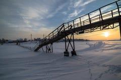 Pontoon bridge over the frozen river Stock Photography