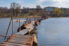 Pontoon-bridge over small river Sura to remote Ukrainian village Rakshivka Royalty Free Stock Photo