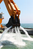 Pontoon Excavators seabed deepens Stock Photo