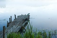 Pontoon in fog. Wooden pontoon in morning fog Royalty Free Stock Photo