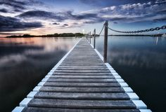 Pontoon jetty across the water Royalty Free Stock Image