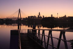 Pontoon jetty near Anzac Bridge, Sydney. Pontoon jetty at dawn, near the ANZAC Bridge, Sydney Harbour, Australia Royalty Free Stock Image