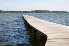 Pontoon lake of Sanguinet in Landes France across the water. Wood pontoon lake of Sanguinet in Landes France across the water Royalty Free Stock Image