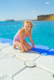 Pontoon pier. Girl walking on the pier Panton over the coral reef Stock Photos