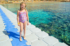 Pontoon pier. Girl walking on the pier Panton over the coral reef royalty free stock photography
