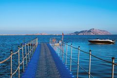 Pontoon in the Red Sea, boat and Tiran Island. In Egypt Royalty Free Stock Image