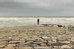 Pontoon on the sea. France Normandy Manche footbridge  facing  a dramatic ocean setting Royalty Free Stock Photo