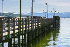 Pontoon on Starnberger lake. With mountains and forest in the horizon, on May 21, 2016, in Starnberg, Germany Royalty Free Stock Image