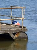 Pontoon with steel railings and bouy. Photo taken on tweed river, gold coast, australia. Pontoon at local dive shop royalty free stock photo