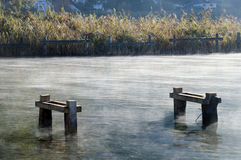 Pontoon structure, reeds and mist on water Royalty Free Stock Photography