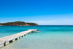 Pontoon  in the turquoise water of  Rondinara beach in Corsica I Stock Photo