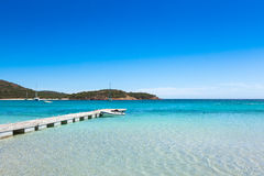 Pontoon  in the turquoise water of  Rondinara beach in Corsica I Royalty Free Stock Image