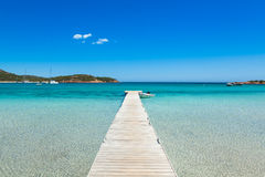 Pontoon  in the turquoise water of  Rondinara beach in Corsica I Royalty Free Stock Images